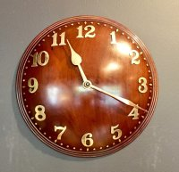OI957 TWENTIES MAHOGANY ZENITH WALL CLOCK